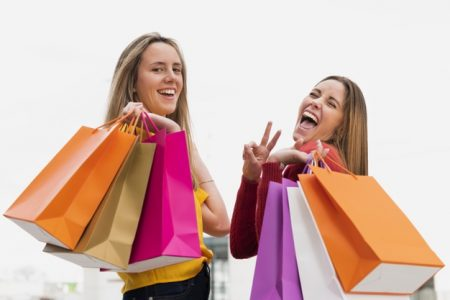 girls-with-shopping-bags-looking-camera_23-2148286221
